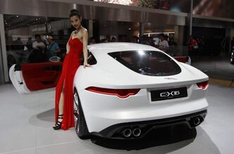 A model poses with a Jaguar C-X16.