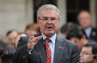 Agriculture Minister Gerry Ritz stands during Question Period in the House of Commons on Parliament Hill in Ottawa on Wednesday. He said the government is appealing a Federal Court ruling that found his government broke the law by introducing a law to end the wheat board's single-desk seller status.