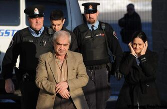 Tooba Mohammad Yahya and husband Mohammad Shafia and their son Hamed Mohammed Shafia are escorted by police officers into the Frontenac County courthouse in Kingston, Ontario on Wednesday.
