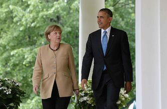 German Chancellor Angela Merkel and U.S. President Barack Obama walk to the Rose Garden of the White House after speaking on Friday, May 2, 2014, in Wasington, D.C.