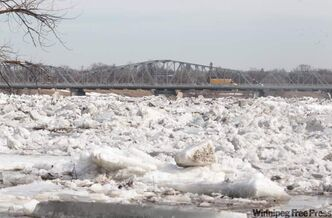 An ice jam is forming at the Redwood Bridge in Winnipeg this morning.