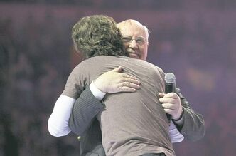 Nobel Peace Prize laureate  Mikhail Gorbachev embraces  We Day co-founder Craig Kielburger.