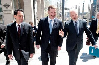 UNITED FRONT: Montreal Mayor Michael Applebaum (from left), federal Minister of Foreign Affairs John Baird, and provincial Minister for International Relations Jean-Francois Lisee leave the International Civil Aviation Organization headquarters Friday.