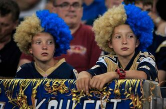 The faces of two young Bombers fans Friday seems to sum up the season so far.