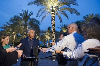 U.S. Secretary of Defense Chuck Hagel speaks with reporters after reading a statement on chemical weapon use in Syria during a press conference in Abu Dhabi, United Arab Emirates on Thursday, April 25, 2013. (AP Photo/Jim Watson, Pool)