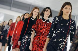 Models display designs, during the Preen catwalk show on day three of London Fashion Week, at the Heron Tower, London, Sunday Feb. 17, 2013. (AP Photo/Dominic Lipinski/PA) UNITED KINGDOM OUT NO SALES NO ARCHIVE