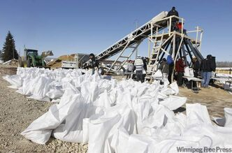 The sandbagging machine at Peguis First Nation, also known as an 'octopus', can make about 4,000 bags a day. Peguis has been gearing up for flooding since late March.