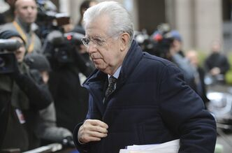Italian Prime Minister Mario Monti arrives for an EU summit in Brussels on Friday, Dec. 14, 2012. France and Germany have had more than their share of difference over the past few months, but this week at long last the two countries were able to find a compromise that allowed the European Union to realize a deal on a banking union. (AP Photo/Geert Vanden Wijngaert)