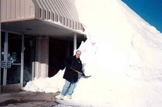 The author pictured after the blizzard of April 1997. Drifts were as high as 12 feet on main thoroughfares.