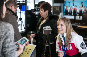 Jennifer Jones, 2014 Olympic curling gold medal winner, laughs with fans as she signs autographs at the Winnipeg Free Press News Café Tuesday afternoon. The Jones rink will drop the puck at the Winnipeg Jets game Tuesday night at MTS Centre.