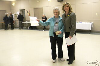 From left to right: June Freeth, treasurer of Vital Seniors, is holding a cheque from the federal New Horizons for Seniors Program with MP Shelly Glover at Mary Magdalene Church on April 8.