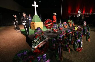 Service members take part in a Remembrance Day service at Winnipeg Convention Centre Sunday.