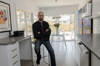 Ivan Plett, project manager for Rempel Builders, poses for a photo in a kitchen that was recently renovated.  EMILY CUMMING / WINNIPEG FREE PRESS