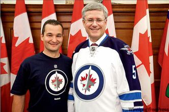Stephen Harper (right) models the Jets' away jersey alongside Winnipeg South MP Rod Bruinooge. It's expected the prime minister will be in town for the opener against Montreal on Oct. 9.