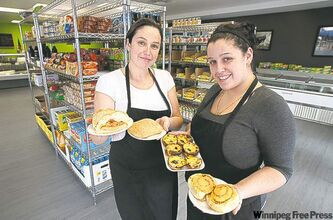 Viena do Castelo owner Ana Godinho Esteves (left) and manager Beta Godinho with an array of baked goods.