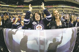 Jets fans cheer on their team Saturday in the last game of the first season the team returned to Winnipeg.