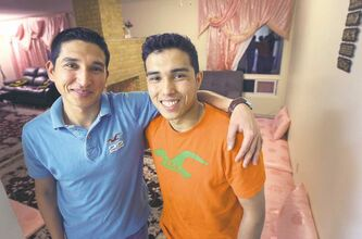 Kahlid Hassani (left, with his brother Qayum), works two jobs, goes to school full time and supports his mother and five siblings -- but he still finds his life here to be a piece of cake compared to growing up in Afghanistan. He won Winnipeg's Youth Role Model Award for courage.