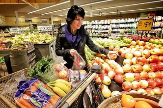 Registered dietitian Gina Sunderland says that healthy foods can be cheaper than unhealthy junk foods. To prove her point she went shopping for her family and filled one cart healthy foods and another with less healthy foods.  130318 March 18, 2013 Mike Deal / Winnipeg Free Press