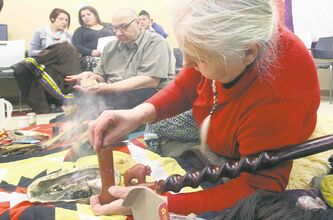 In this January 2013 photo, elder Velma Orvis (right) packs a ceremonial pipe as she and elder Albert McLeod (centre) prepare the key elements for a smudge ceremony prior to an event at the Nine Circles Community Health Centre.  Despite historical attempts to stifle First Nations culture, it�s now increasingly common to see smudge ceremonies performed before public events in Winnipeg � especially those held in the North End.
