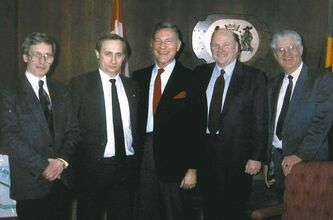 Harry Giesbrecht (far right) stands with dignitaries including Vladimir Putin, (second from left) before Putin became the president of Russia.