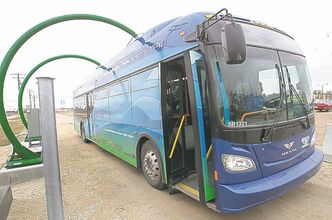 The first electric bus made in Manitoba recharges on Taylor Avenue Friday.