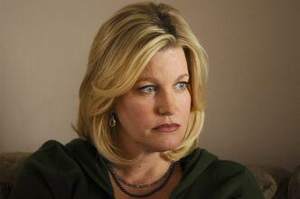 Anna Gunn as Skyler White in