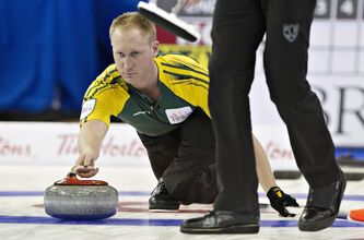 Northern Ontario skip Brad Jacobs throws a rock during the first draw at the Tim Hortons Brier in Edmonton on Saturday.