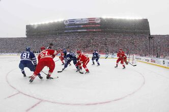 The Toronto Maple Leafs and the Detroit Red Wings face off during the first period of the Winter Classic outdoor NHL hockey game at Michigan Stadium in Ann Arbor, Mich., Wednesday.