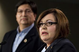 National Vice-Chief Ron Swain looks on as Congress of Aboriginal Peoples National Chief Betty Ann Lavall�e responds to a question during a news conference about the impact of a federal court decision on M�tis and Non-Status Indians Tuesday, January 8, 2013 in Ottawa. THE CANADIAN PRESS/Adrian Wyld