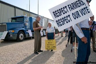 Farmers rally outside the Canadian Wheat Board Forum directors meeting in Oak Bluff Wednesday.