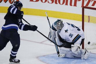 JOHN WOODS / WINNIPEG FREE PRESS  The NHL's No.1-ranked shootout player scores the winner against Antti Niemi Sunday — in a shootout, of course. Andrew Ladd wasn't always as successful.