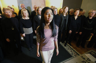 Maria Aragon, backed by the Winnipeg Philharmonic Choir, sings her benefit single, United We stand, at Private Ear recording studio.