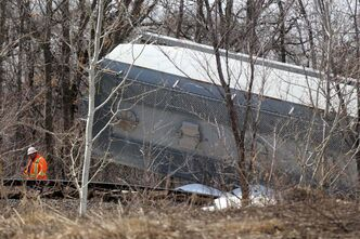 CN workers assess the scene after the derailment of five railcars south of St. Norbert Sunday.