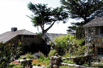 Tor House was painstakingly hand-built by American poet Robinson Jeffers, who hauled rock up from his beach.