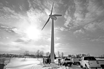 A windmill at Chaska, Minn., is serviced. Minnesota can store wind energy with Manitoba Hydro.