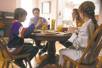 From left, Keidrich Sellati as Henry Jennings, Mathew Rhys as Philip Jennings, Keri Russell as Elizabeth Jennings, Holly Taylor as Paige Jennings.