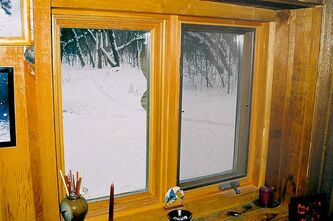 Douglas fir tripane low-E argon window in cedar wall.