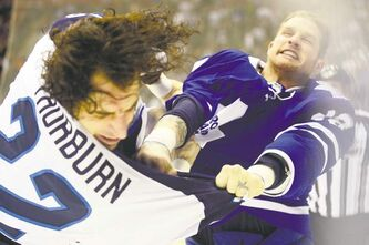 Aaron Harris / REUTERS Winnipeg's Chris Thorburn (left) and Toronto's Colton Orr renew hostilities Saturday night in a first-period scrap.