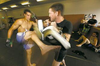 Roland Delorme works out with Curtis Brigham at the Winnipeg Academy of Mixed Martial Arts.