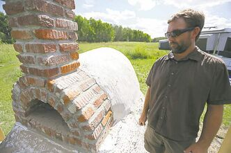 Trevor with the newly built cob oven.