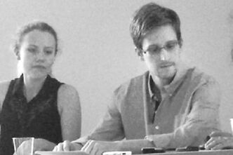 NSA leaker Edward Snowden attends a news conference at Moscow's  Sheremetyevo Airport with Sarah Harrison of WikiLeaks last month.