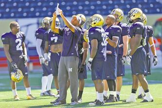 Blue Bombers defensive backs coach Carl Franks instructs his charges during Thursday's practice at Investors Group Field.
