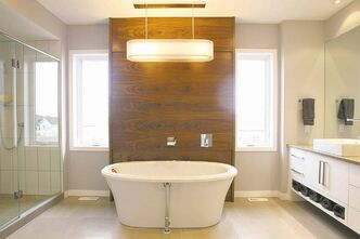 Walnut backdrop set behind a free-standing soaker tub.