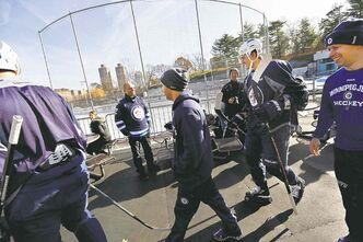 Mark Scheifele (second from right) approaches the Central Park rink for the outdoor practice session.