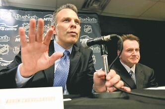 Jets general manager Kevin Cheveldayoff (left) isn't going to rush into pushing a panic button.