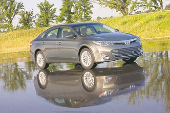 The 2013 Toyota Avalon hybrid is almost identical to the redesigned gasoline-only Avalon, with the main differences being under the skin. (Toyota/MCT)