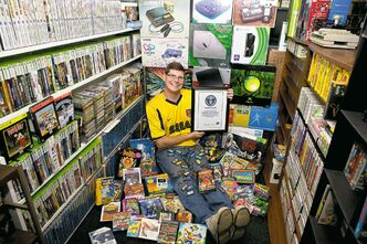 Michael Thomasson stores his collection of 10,607 video games in his basement.