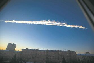 FILE - In this Feb. 15, 2013 file photo provided by Chelyabinsk.ru, shows a meteorite contrail over the Ural Mountains� city of Chelyabinsk, about 930 miles east of Moscow, Russia. After a surprise meteor hit Earth at 42,000 mph and exploded over a Russian city in February, smashing windows and causing minor injuries, scientists studying the aftermath say the threat of space rocks hurtling toward our planet is bigger than they had thought. Meteors like the one that exploded over Chelyabinsk _ and those that are even bigger and more dangerous _ are probably four to five times more likely to hit Earth than scientists thought before the February mid-air explosion, according to three studies released Wednesday in the journals Nature and Science. (AP Photo/Chelyabinsk.ru, Yekaterina Pustynnikova, File)