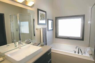 The spa-like ensuite has been outfittd with a soaker tub, corner shower and spacious walk-in closet.