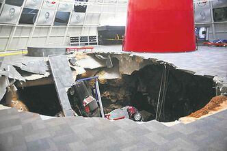 Eight cars collapsed into a sinkhole at the National Corvette Museum in Bowling Green, Ky., on Wednesday. The museum still opened but closed off the damaged area.
